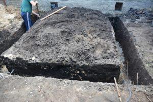 Beaverton worker digging home foundation